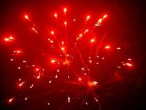 Fuoco d'artificio su fondo rosso Fotografia Stock Libera da Diritti