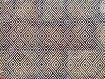 Fuoco selettivo di progettazione astratta del modello delle mattonelle decorative da laminare sul pavimento immagini stock libere da diritti