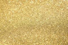 Fuoco selettivo di scintillio dell'oro Fotografie Stock Libere da Diritti