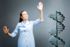 Fuoco selettivo sul modello 3d di DNA Fotografia Stock