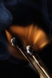 Fuoco - una bruciatura delle due corrispondenze Fotografie Stock Libere da Diritti