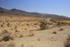 Fuori dalla strada del deserto Immagine Stock Libera da Diritti