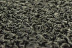 The fur is black karakul lambskin texture, background. The fur is black karakul lambskin texture Royalty Free Stock Images