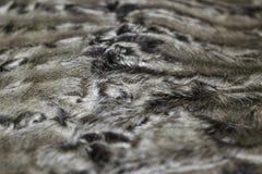 The fur is black karakul lambskin texture, background. The fur is black karakul lambskin texture Royalty Free Stock Photo