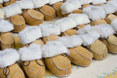 Fur boots. Handcrafted fur boots at the shoes shop Stock Photo