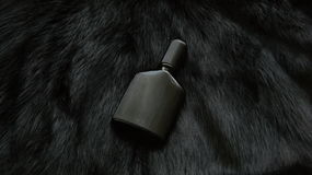 Fur and bottle of perfume Stock Images