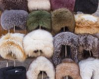 Fur caps winter headwear. Trading with fur hat. Selling natural winter fur headdress. royalty free stock photos