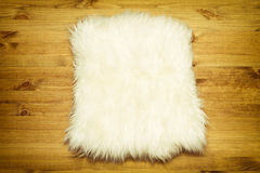 Fur carpet on wood floor Royalty Free Stock Images