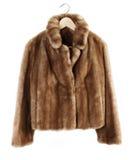 Fur coat. On hanger isolated on plain background Stock Photo