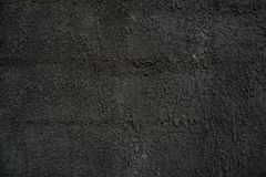 Fur coat of cement with sand of dark gray color solid concrete stock photo