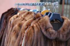 Fur coat for sale in the flea market Stock Photography