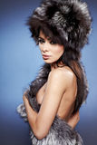 Fur Fashion. Beautiful Girl in Fur Hat. Stock Images