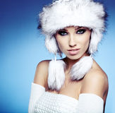 Fur Fashion. Beautiful Girl in Fur Hat. Royalty Free Stock Image