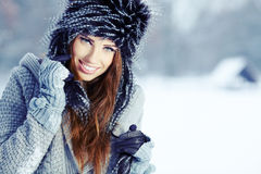 Fur Fashion. Beautiful Girl in Fur Hat. Royalty Free Stock Photo