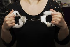 Fur handcuffs, sex toy in female hands royalty free stock photo