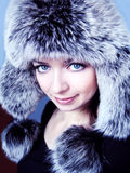 Fur hat. Beautiful woman in fur hat blue toned Royalty Free Stock Photo