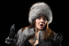 Fur hat. Portrait of a beautiful young woman in a fur hat, cape and leather gloves Stock Images