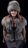 Fur hat. Portrait of a beautiful young woman in a fur hat, cape and leather gloves Royalty Free Stock Photos