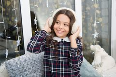 Fur headphones accessory. Girl cute child wear soft furry headphones. Warm fashion accessory. Winter fashion. Feel soft. And warm. Fur headphones keep ears warm royalty free stock images