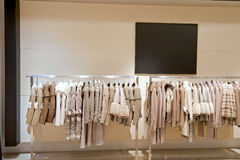 Fur store. New elegant female fur colection on a hangers in a fashion store royalty free stock photo