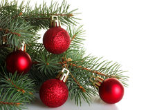 Fur-tree branch with Christmas balls Royalty Free Stock Photography