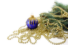 Fur-tree with a Christmas ball and a beads Royalty Free Stock Photos