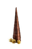 Fur-tree of the conic form with gold cones isolate. Original fur-tree of the conic form with gold cones isolated on a white background Royalty Free Stock Photo