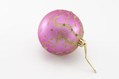 Fur-tree toy - a pink sphere. On the white backgroud stock images