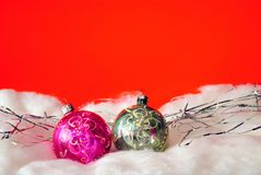 Fur-tree toys on a red background. Fur-tree spheres in snow on a red background Stock Images