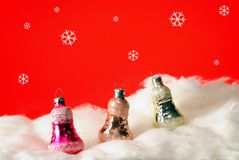 Fur-tree toys on a red background. Fur-tree toys in snow on a red background Royalty Free Stock Photos