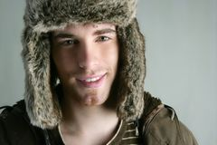 Fur winter fashion hat young man brown autumn. Color Stock Images