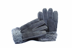 Fur winter gloves grey colors on the white background. Stock Photos