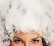 Fur winter hat of a young brunette Caucasian woman Royalty Free Stock Photos