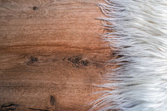 Fur on wood background Royalty Free Stock Photography