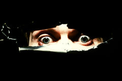 Furchtsame Augen eines Mannes Stockfotografie