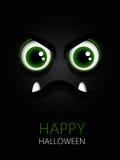 Furchtsame grüne Augen mit Halloween-Wünschen Stockfotos