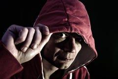 Furchtsamer Mann mit Haube Stockfotos