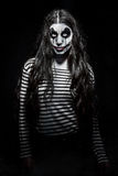 Furchtsames schlechtes Clownmädchen Stockfotos