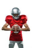 Furious American Football Player In Red Jersey And Helmet Holding Ball Royalty Free Stock Photo