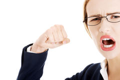 Furious angry business woman trying to punch you. Royalty Free Stock Photography