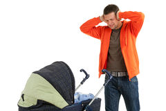 Furious, angry father with baby  buggy Stock Photography