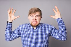 Furious angry man with rage and frustration. Furious angry man screaming with rage and frustration Stock Photo