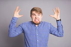 Furious angry man with rage and frustration. Furious angry man screaming with rage and frustration Stock Image