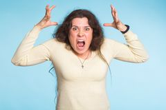 Furious angry woman with rage and frustration. Furious angry woman screaming with rage and frustration Stock Photos
