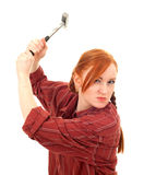 Furious, angry young woman with hammer Stock Photo