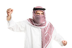 A furious arab man with covered face protesting Stock Photo