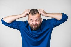 Crazy mad adult man. Furious bearded adult man, guy acting crazy being mad having mental crisis stock image