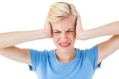 Furious blonde woman holding her head Royalty Free Stock Image