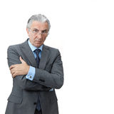 Furious boss. Furious senior boss crossing arms Stock Photos