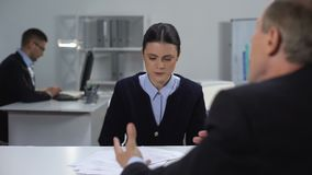 Furious boss screaming on crying female employee, angry manager throwing papers. Stock footage stock footage